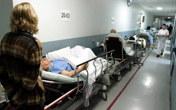Patients line up on hospital beds outside the crowded emergency room at Montreal's Sacre Coeur Hospital Thursday, Nov. 28, 2002. After several years of progress, it appears some provinces are slipping in their quest to reduce the time it takes to receive a number of benchmark medical treatments. - http://news.nationalpost.com/2012/06/20/wait-times-on-the-rise-in-canadian-hospitals/